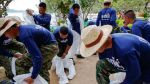 Soldiers change into white biohazard suits as they take part in a clean-up operation at Ao Prao Beach on Koh Samet, Rayong